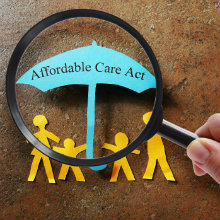 A paper cutout family under an Affordable Care Act umbrella